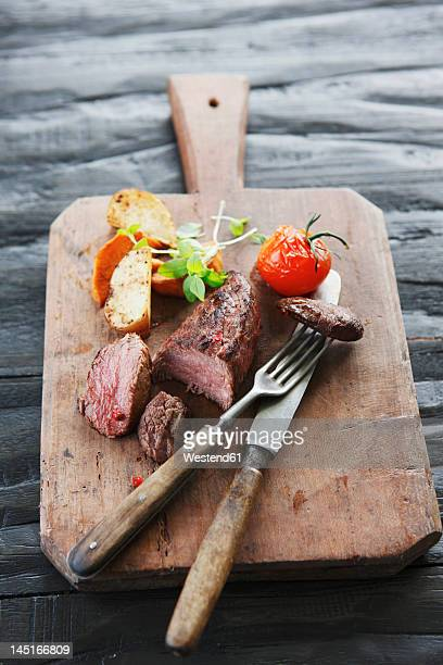Germany, Bremen, Steak with vegetable on chopping board