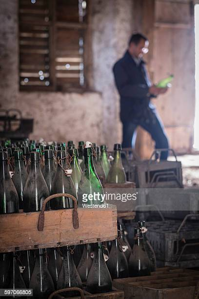 Germany, Burghausen, old wooden beer crates with empty beer bottles at Raitenhaslach Abbey