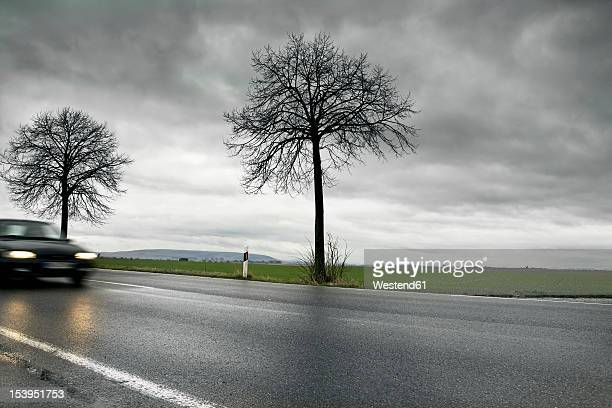Germany, Car passing through country road