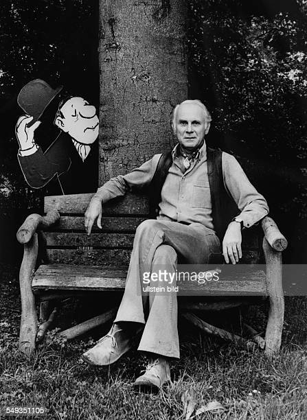 Germany cartoonist Vicco von Buelow Loriot in his garden with one of his cartoon figures