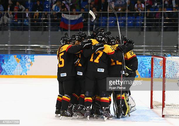 Germany celebrate after beating Japan 32 during the Women's Classifications Game on day 11 of the Sochi 2014 Winter Olympics at Shayba Arena on...