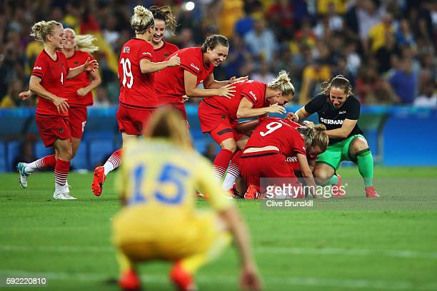 Germany celebrate victory in the Women's Olympic Gold Medal match between Sweden and Germany at Maracana Stadium on August 19 2016 in Rio de Janeiro...