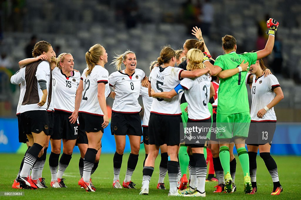Germany celebrate winning the Women's Semi Final match between Germany and Canada on Day 11 of the Rio 2016 Olympic Games at Mineirao Stadium on...
