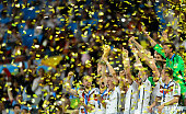 Germany celebrate with the World Cup trophy after defeating Argentina 10 in extra time during the 2014 FIFA World Cup Brazil Final match between...