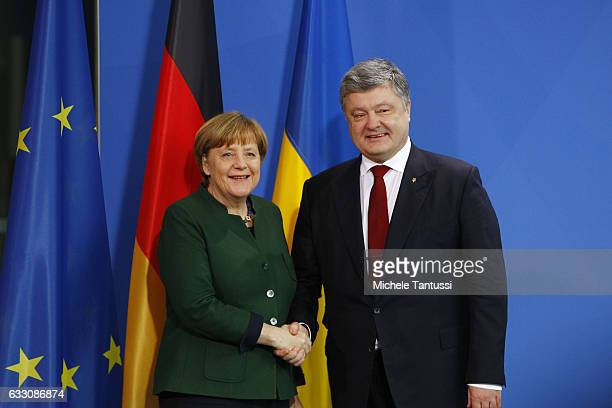 Germany Chancellor Angela Merkel and Ukraine's President Petro Poroschenko shake hands after a Press conference in the Germany Chancellery on January...