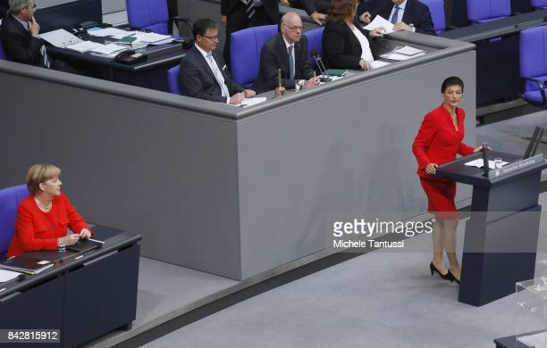 Germany Chancellor Angela Merkel listens to Linke chairwoman Sahra Wagenknecht in the plenary hall of the german parliament or Bundestag after her...