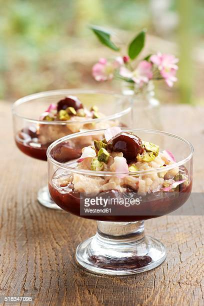 Germany, Cinnamon rice pudding with cherry compote and pistachios