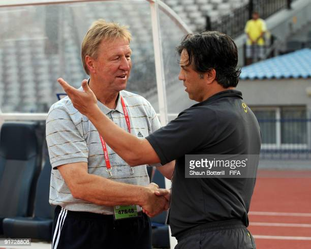 Germany coach Horst Hrubesch meets up with Brazil coach Rogerio before the FIFA U20 World Cup Quarter Final match between Brazil and Germany at the...