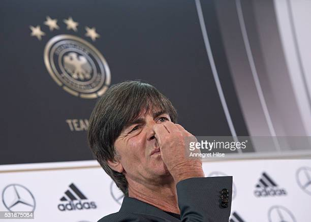 Germany coach Joachim Loew looks during a press conference to announce the German UEFA EURO 2016 squad at the French Embassy on May 17 2016 in Berlin...