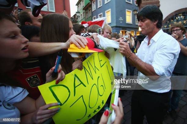 Germany coach Joachim Loew signs autographs after a reception in his honour on September 9 2014 in Freiburg im Breisgau Germany