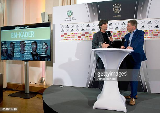 Germany coach Joachim Loew talks to Jens Grittner spokesman of DFB during a press conference to announce the German UEFA EURO 2016 squad at the...