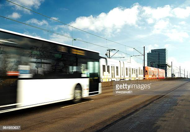 Germany, Cologbe, Bus and tram crossing bridge