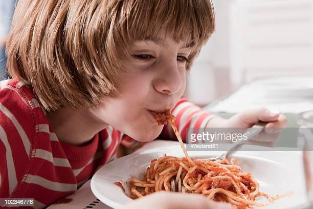 germany, Cologne, Boy (6-7) eating spaghetti, close-up