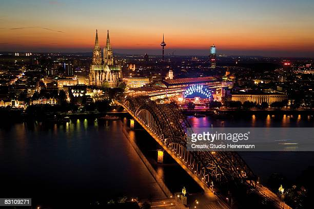 Germany, Cologne, Hohenzollern bridge and Cologne Cathedral at night, high angle view