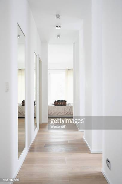 Germany, Cologne, Corridor with bed and suitcase