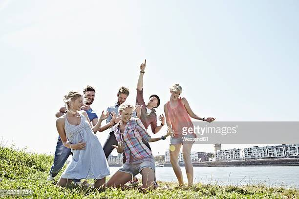 Germany, Cologne, Group of people playing air guitar
