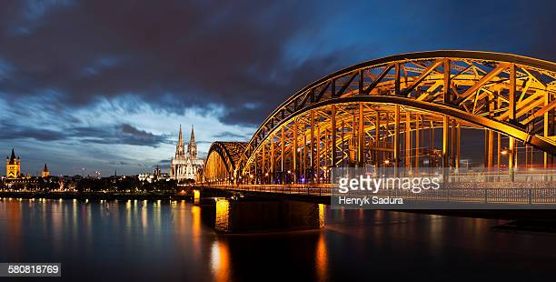 Germany, Cologne, Hohenzollern Bridge illuminated at dusk