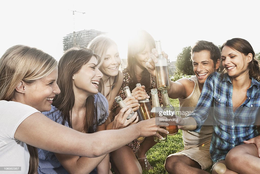 Germany, Cologne, Man and women enjoying beer : Stock Photo