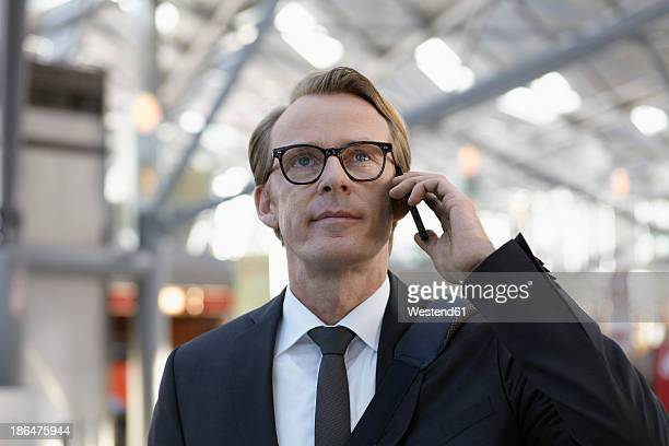 Germany, Cologne, Mature man on phone at airport