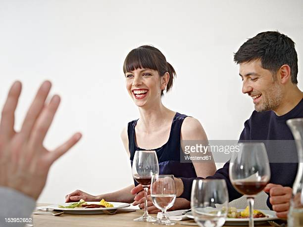 Germany, Cologne, Men and woman having dinner