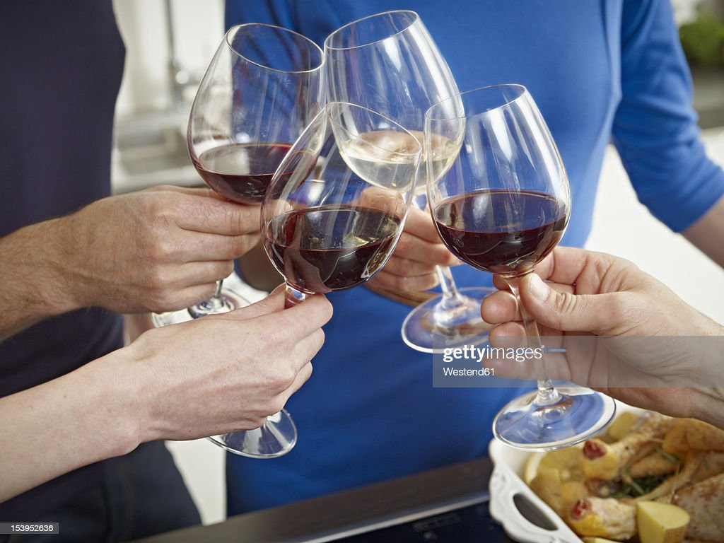 Germany, Cologne, Men and women clinking glasses : Stock Photo