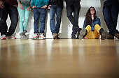 Germany, Cologne, Men and women standing and sitting on floor