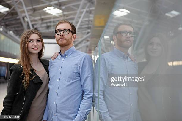 Germany, Cologne, Mid adult man and teenage girl at airport