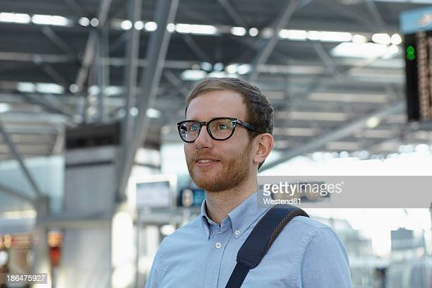 Germany, Cologne, Mid adult man with bag strap