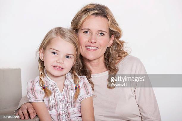 Germany, Cologne, Mother and daughter (4-5) smiling, portrait