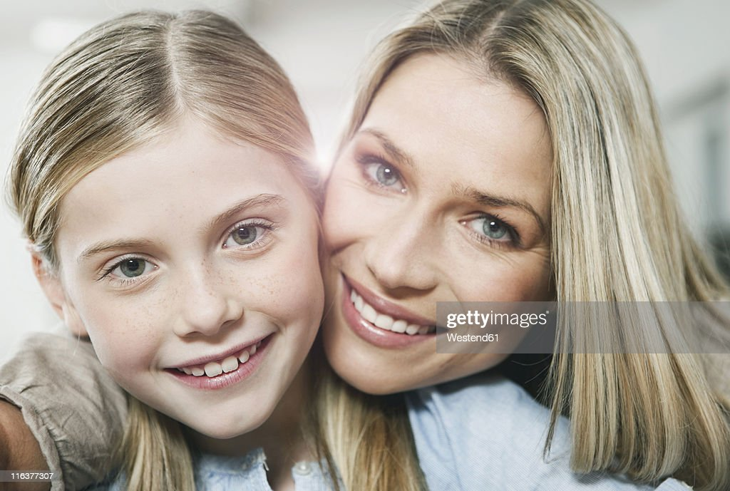 Germany, Cologne, Mother and daughter smiling, portrait : Stock Photo