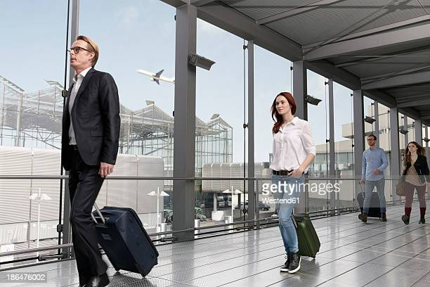 Germany, Cologne, People with baggage at airport