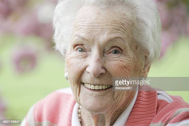 Germany, Cologne, Portrait of senior woman smiling, close up