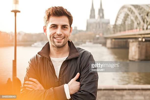 Germany, Cologne, portrait of smiling young man