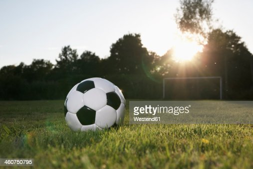 Germany, Cologne, Soccer ball on football field
