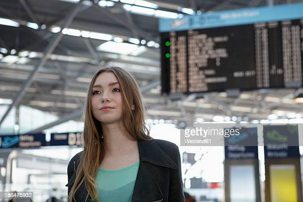 Germany, Cologne, Teenage girl at airport