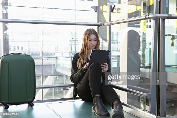 Germany, Cologne, Teenage girl using digital tablet