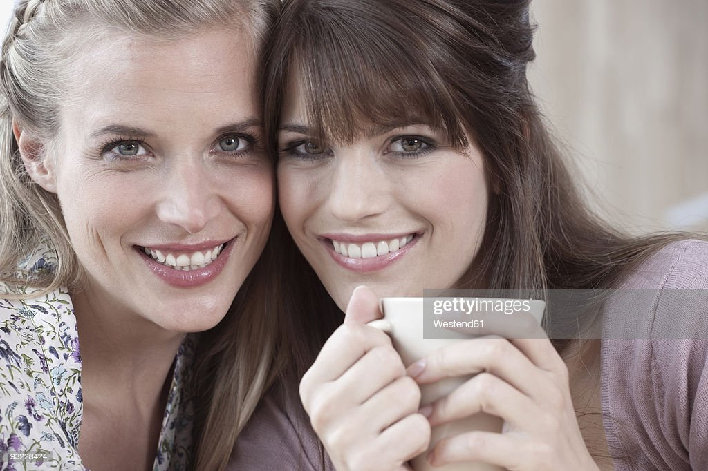Germany, Cologne, Two women smiling, portrait, close-up : Stock Photo