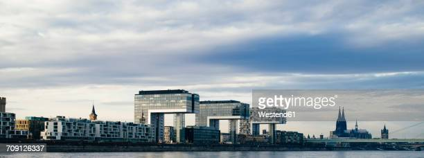 Germany, Cologne, view to Crane Houses at Rhine harbour and Cologne Cathedral in the background