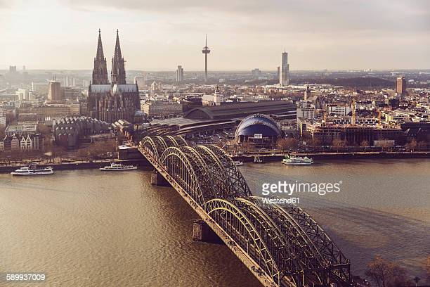 Germany, Cologne, view to skyline with Rhine River and Hohenzollern Bridge in the foreground
