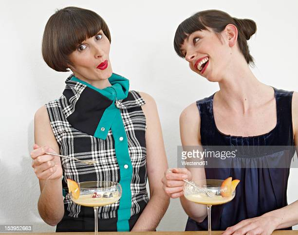 Germany, Cologne, Women eating dessert in kitchen