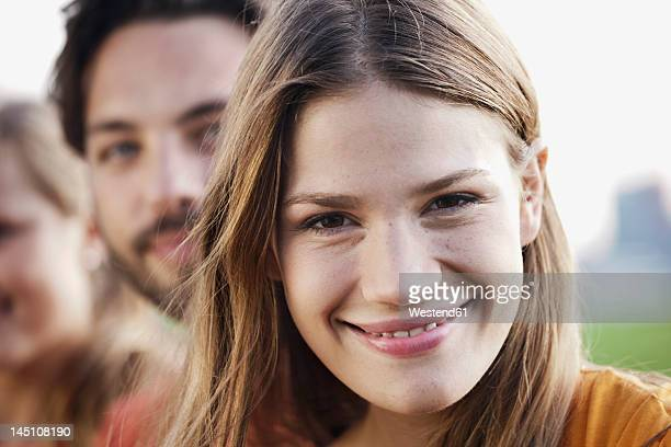 Germany, Cologne, Young man and woman smiling, close up