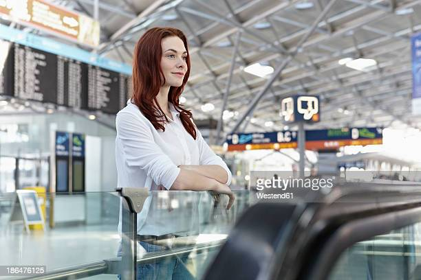 Germany, Cologne, Young woman at airport