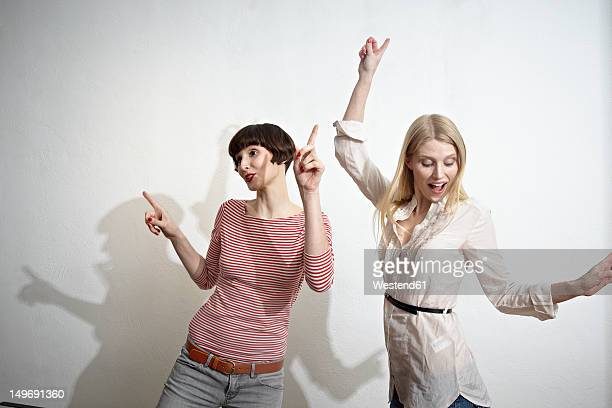 Germany, Cologne, Young women having fun, smiling