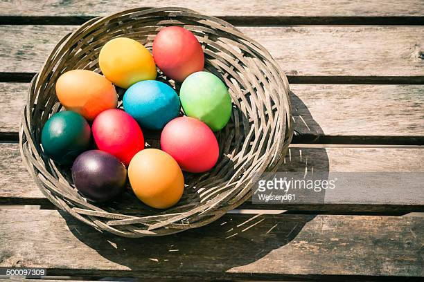 Germany, Colorful Easter eggs on wooden table