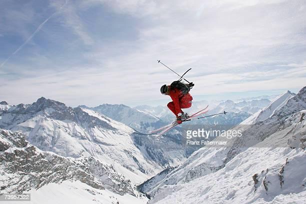 Germany, Damkar, person jumping ski, side view