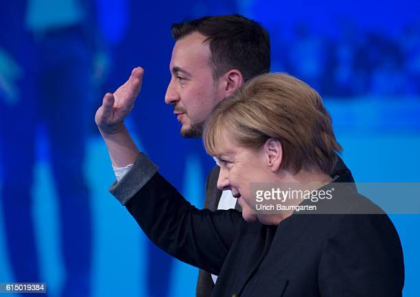 Germany Day of the Young Union in Paderborn Federal Chancellor Angela Merkel waving after her speech In the background Paul Ziemiak JU Chairman
