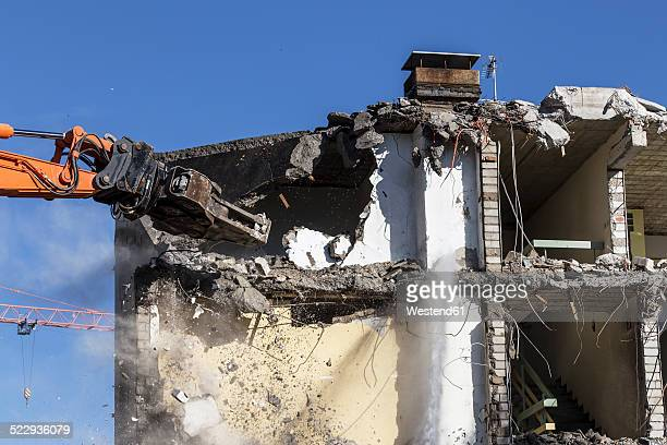 Germany, demolition equipment knocking down an old multi-family house
