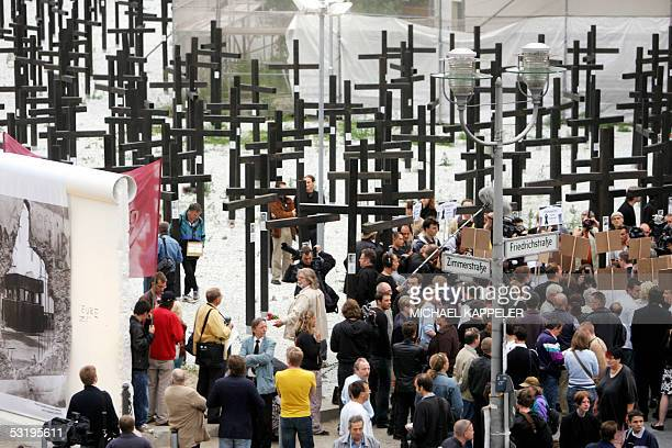 Demonstrators gather in front of a memorial site at the former Checkpoint Charlie 05 July 2005 in Berlin during the removal of the site by the police...