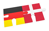 Germany Denmark Partnership Concept: German Flag And Danish Flag Puzzle Pieces, 3d illustration isolated on white background