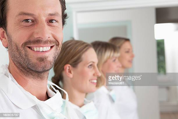 Germany, Dentist and assistance smiling
